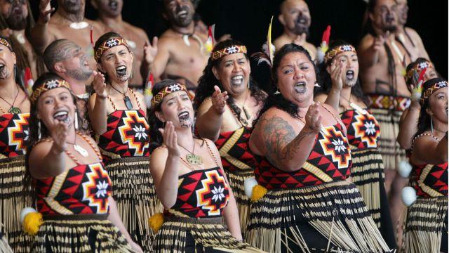 Women and men perform kapa haka.