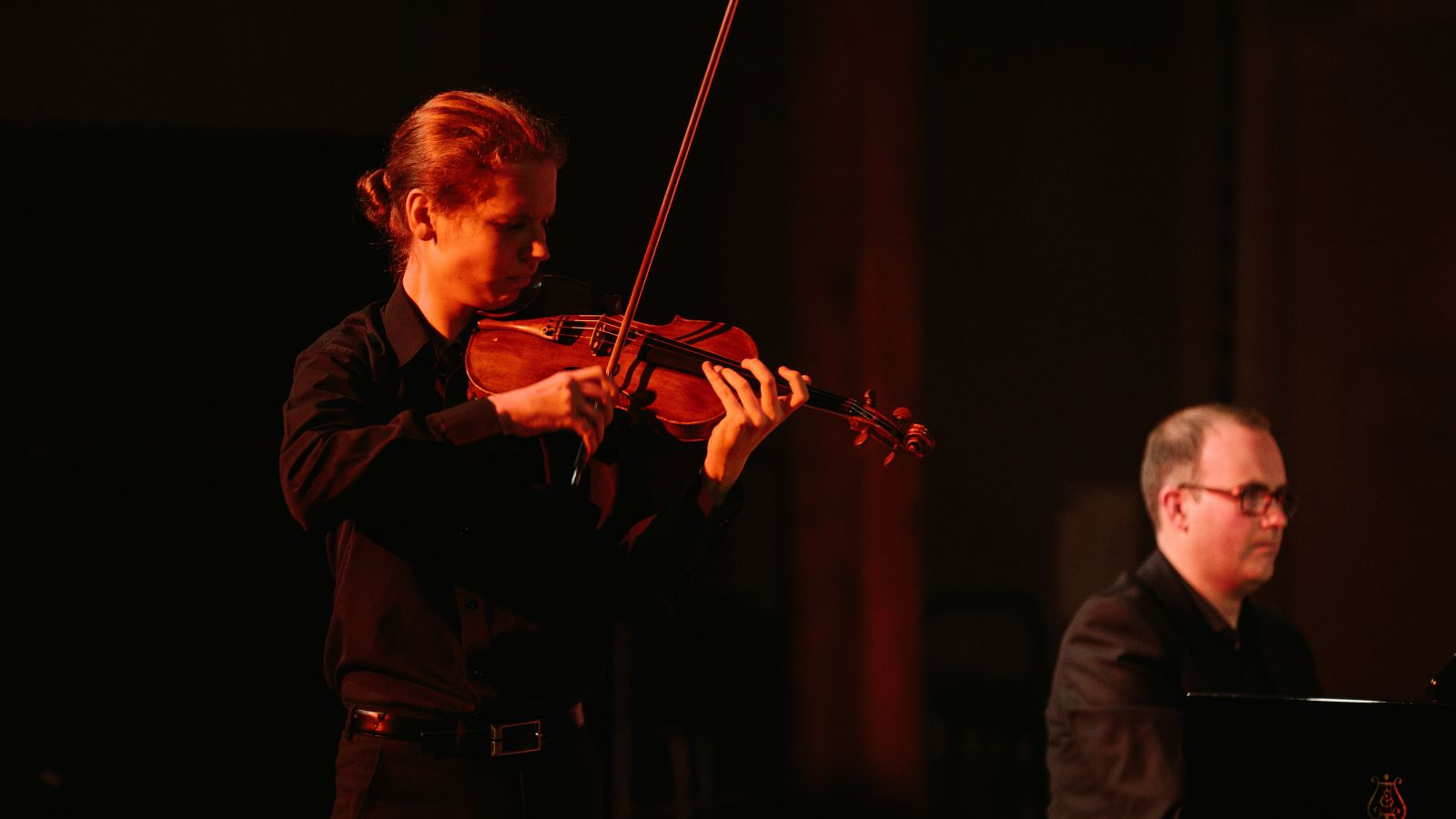 A violinist and pianist perfom