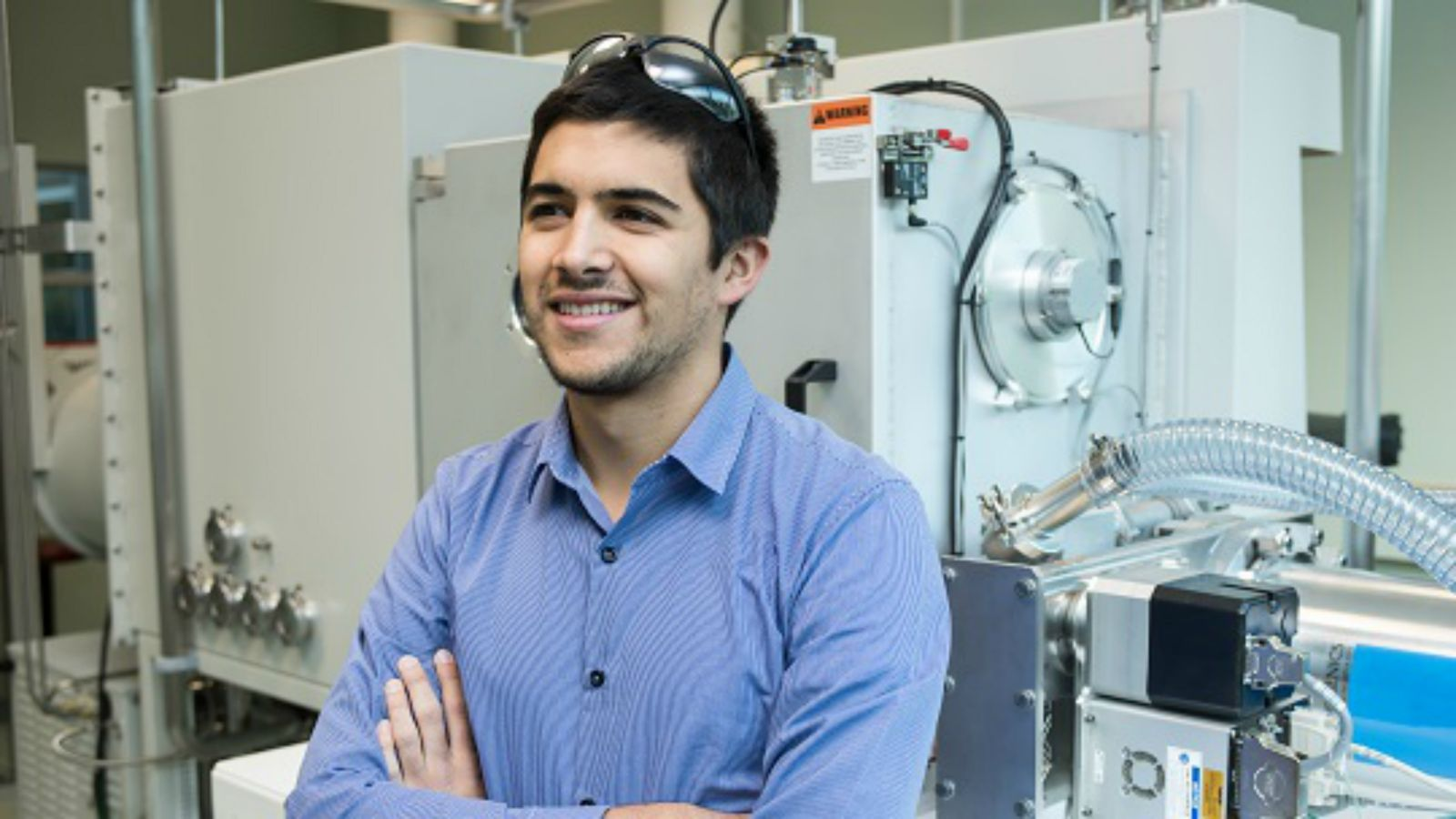 Aleksa Djorovic stands in lab