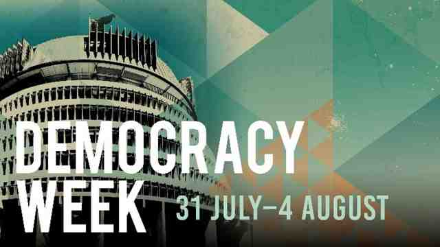 Text saying democracy week with dates 31 July–4 August and the Beehive in the background.