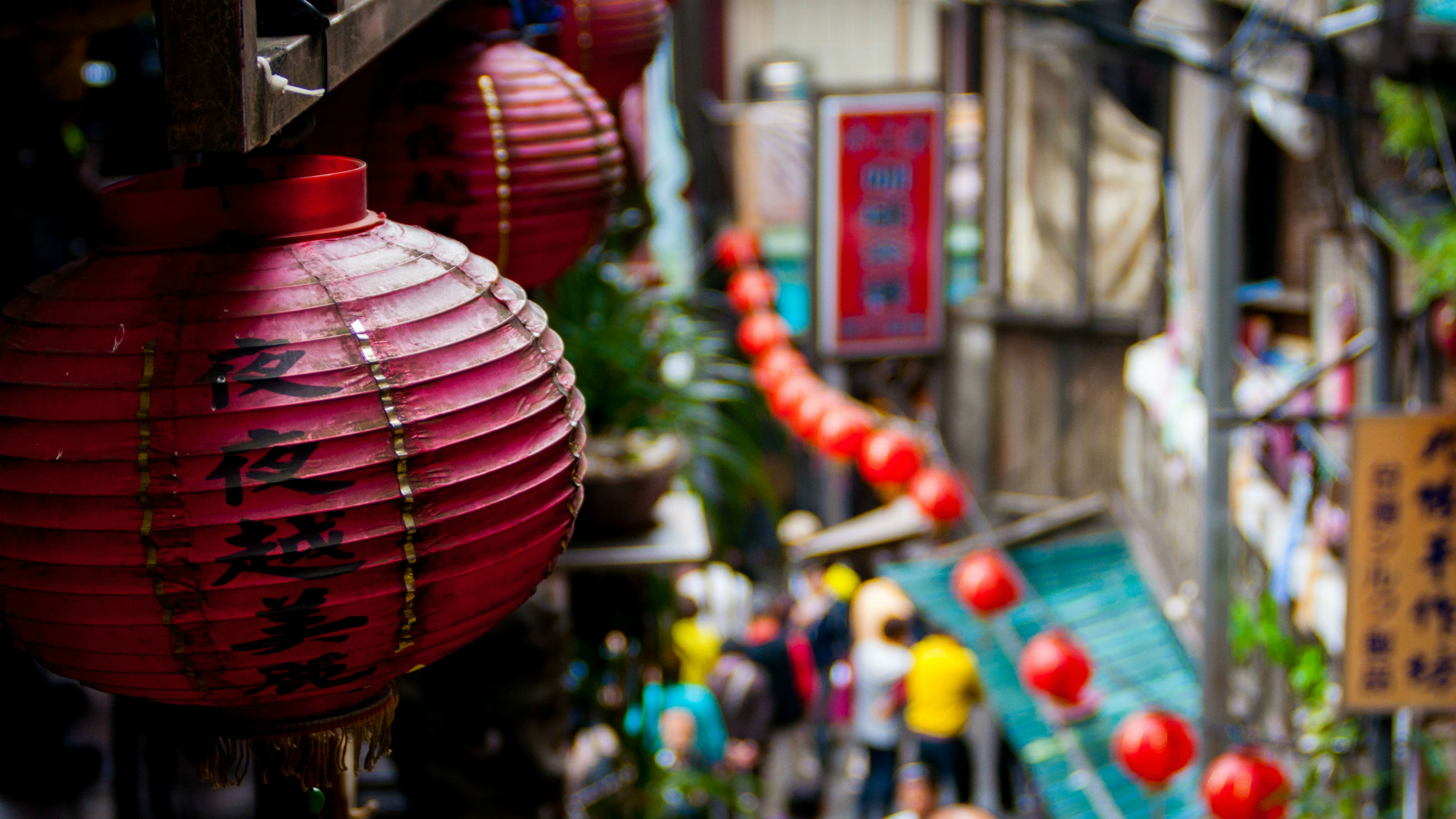 A Chinese street lined with red lanterns.
