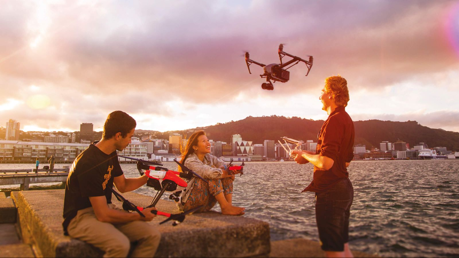 Engineering students Daniel Forbes, Charlene Leong and David Dobbie test out drones on Wellington's waterfront.