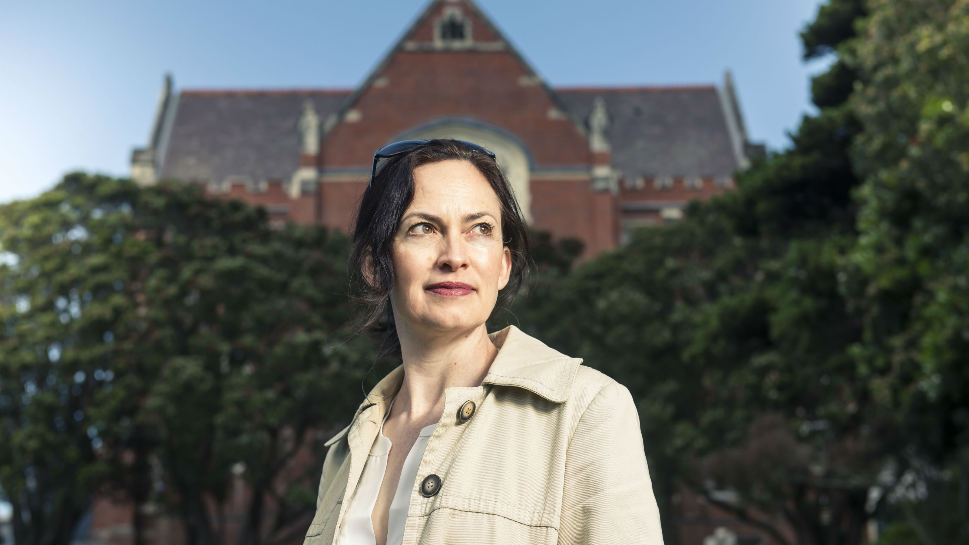 Associate Professor Rebecca Priestley stands outside the red brick hunter building