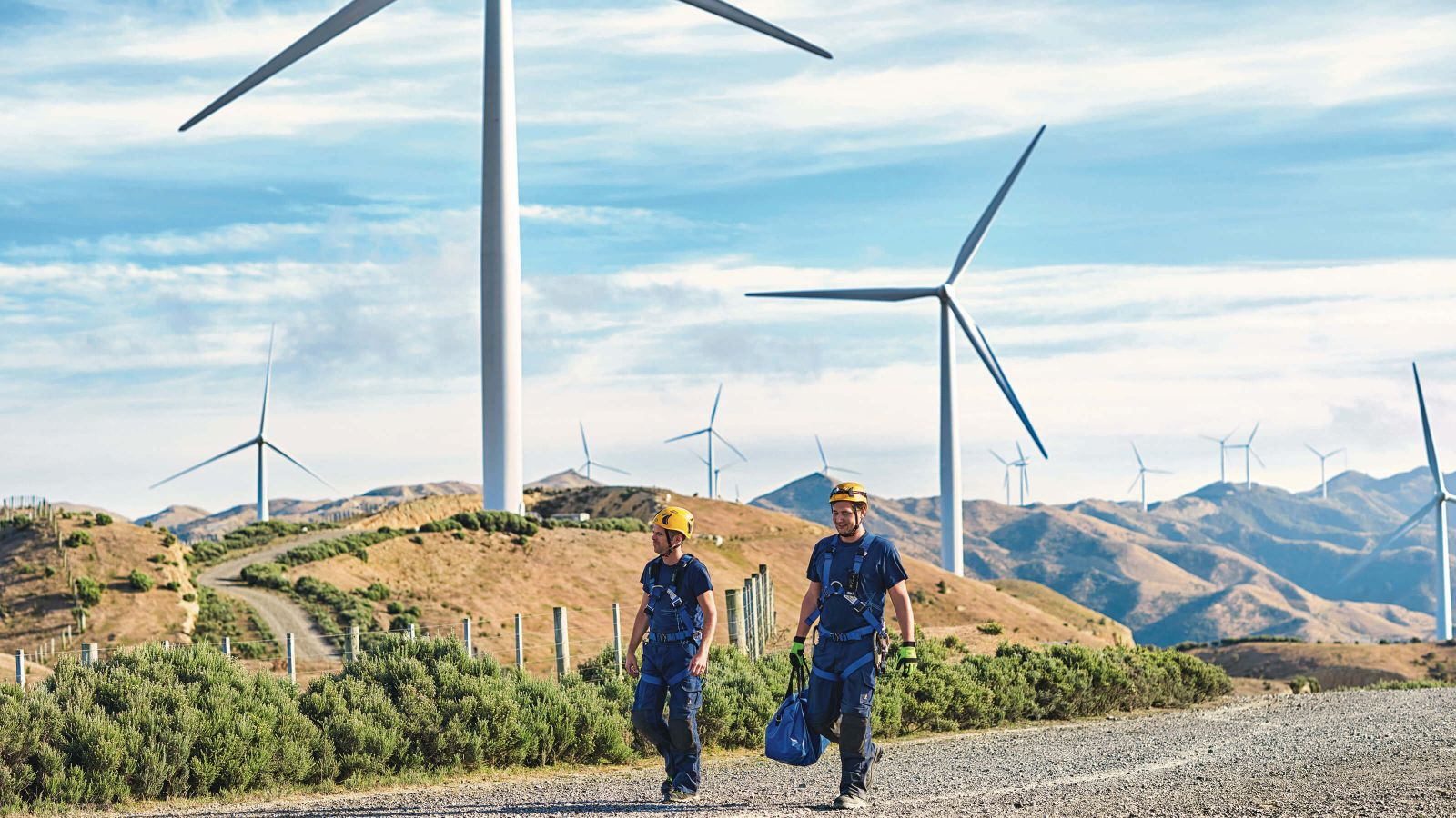 Two people wearing safety harnesses at Makara windfarm
