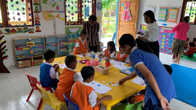 Students participate in reading activities in their colourful classroom.