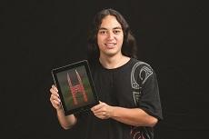 Te Aka Hamilton-Katene holding iPad with digital image of the Waharoa