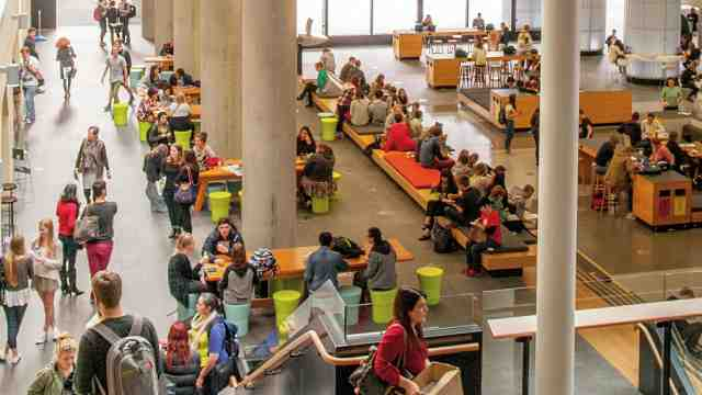 Students milling around in the Hub on Kelburn Campus