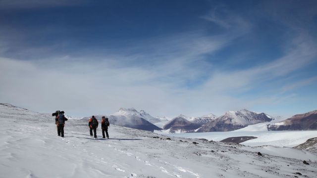 Three explorers in Antarctica.