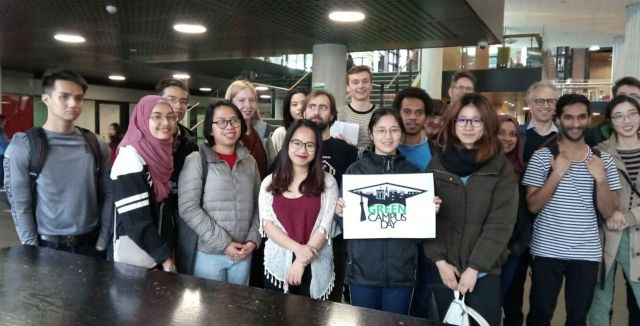 Crowd of students with Green Campus poster
