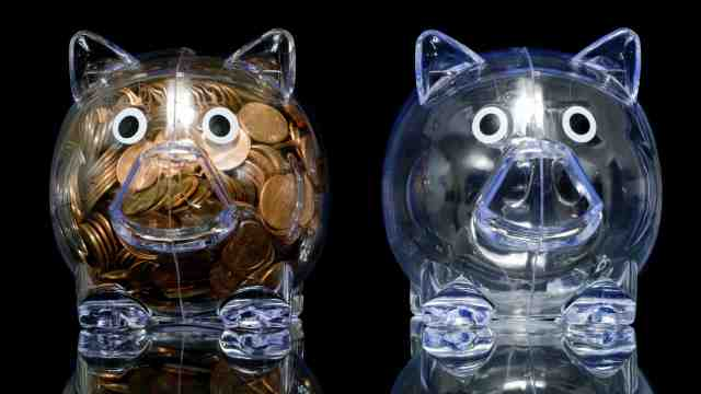 One full piggy bank and one empty piggy bank.