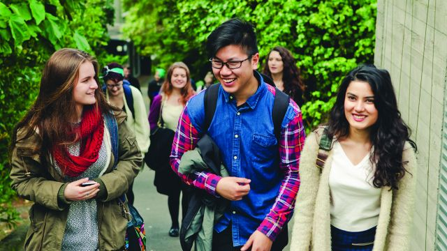A group of university students walking up Mount Street towards the Kelburn campus.