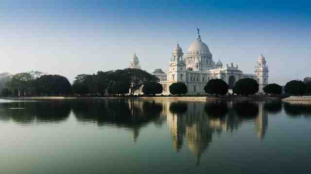 A view of the Victoria Memorial building in Kolkata from across the river.