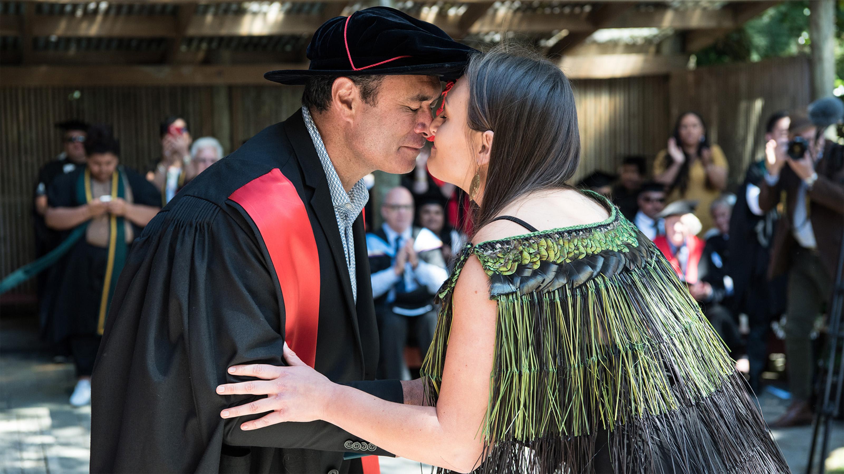 Te Kawa a Māui pūkenga/lecturer, Dr Mike Ross (nō Ngāti Hauā) and student, Ngarangi Williams (nō Ngāti Awa, Ngāti Kahungunu me Ngāi Tūhoe) at Marae Graduation, December 2016.
