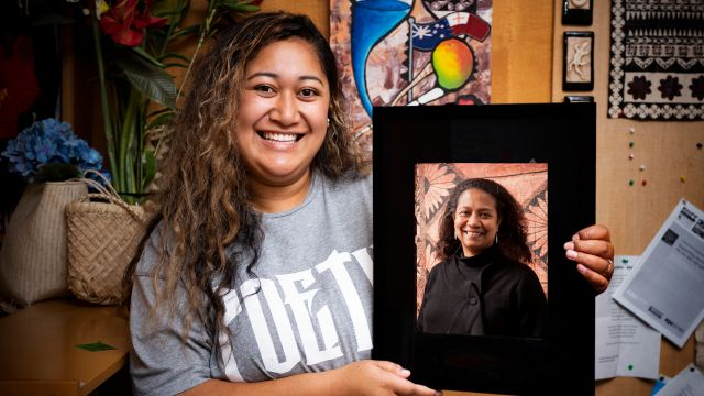 Alilia Tupou with a portrait of Associate Professor Teresia Teaiwa