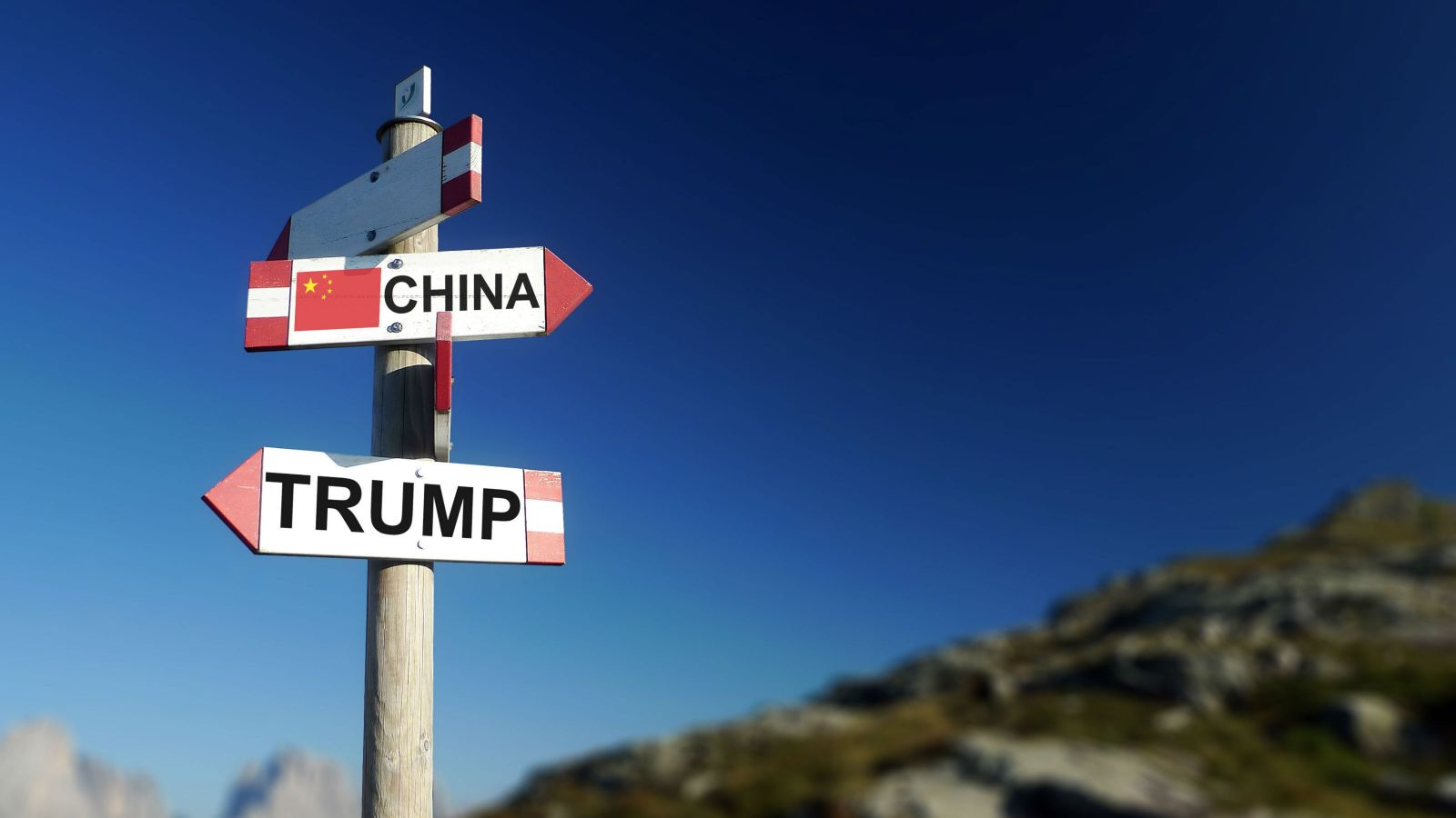 Direction sign post with Trump and China