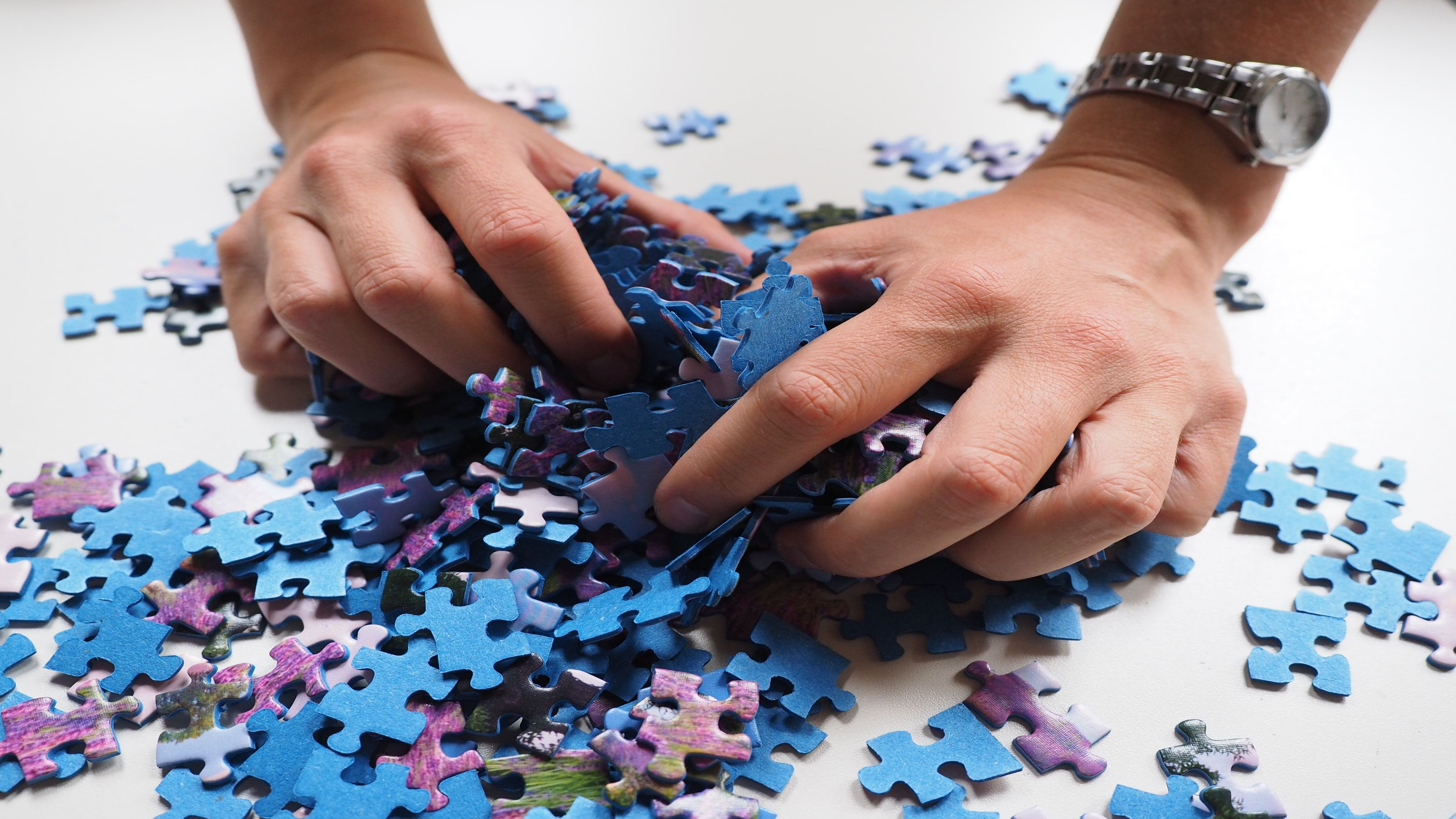 hands clenching puzzle pieces