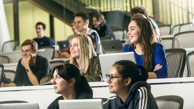 Gina Murphy is sitting with other students in a lecture theatre in Te Toki a Rata Building.