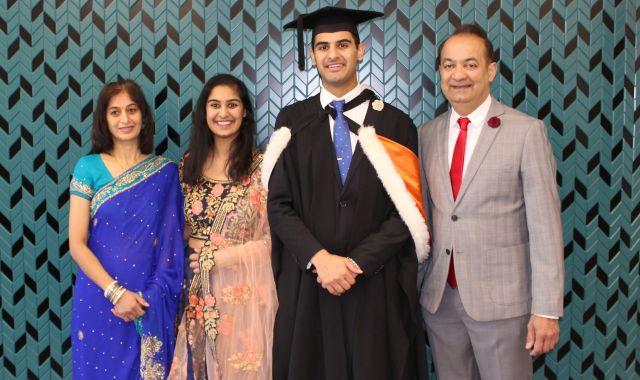Bhavin celebrates graduation with his mother Nikita Parshottam (left), his sister Pooja Parshottam (second left), and his father Nitin Parshottam (right).
