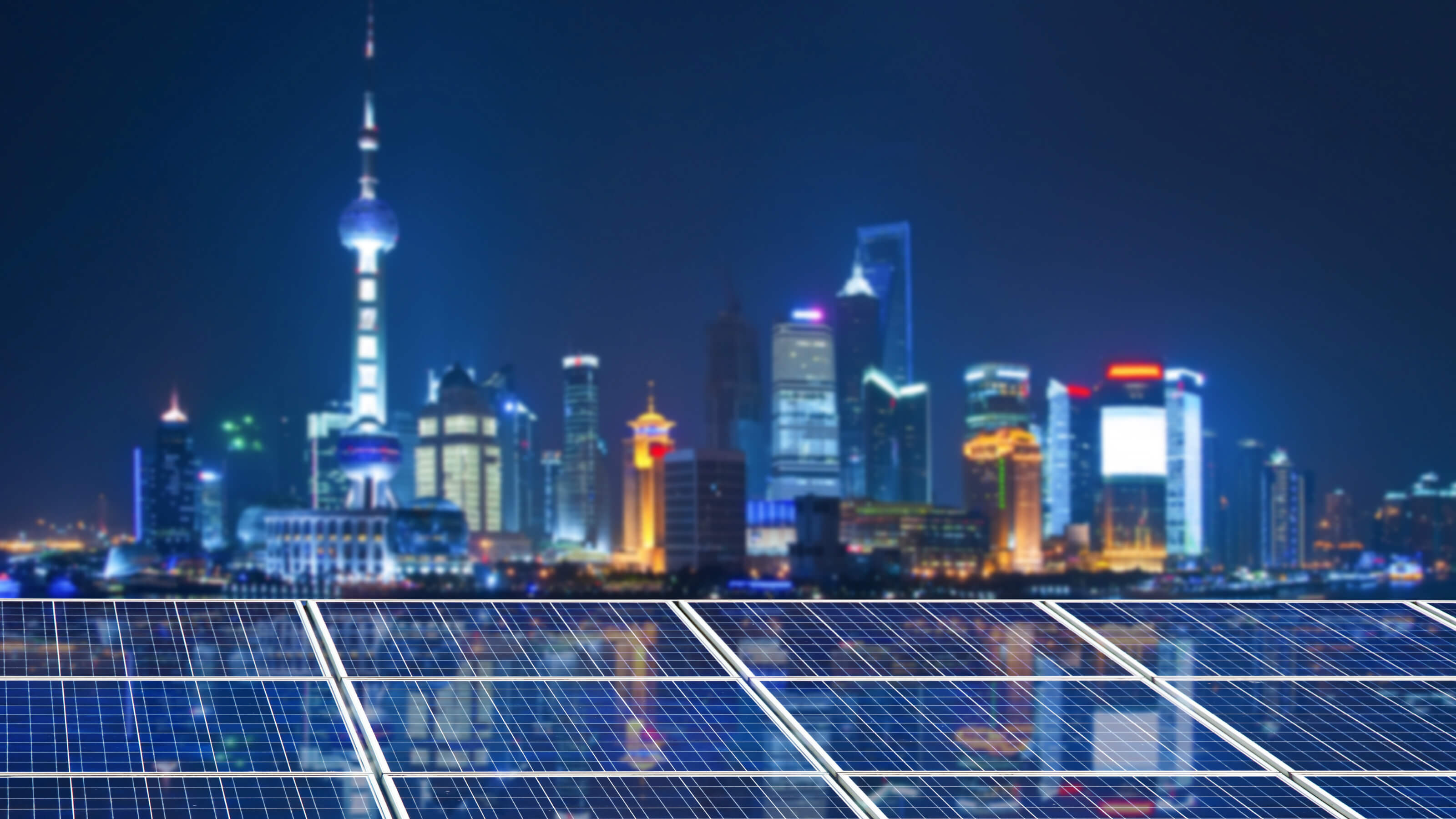 Image of Shanghai skyline with solar panels in front