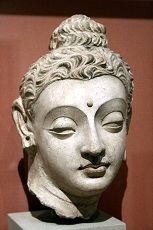 Stone carving of head of Buddha