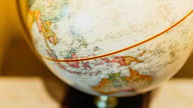 A world globe with a golden backlight.