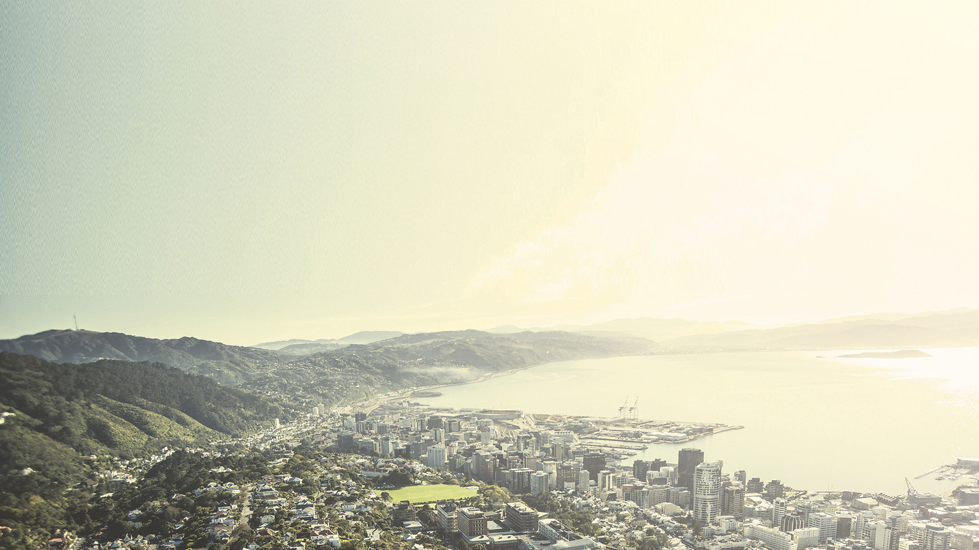 A wide shot of Wellington harbour with Wellington city in the foreground