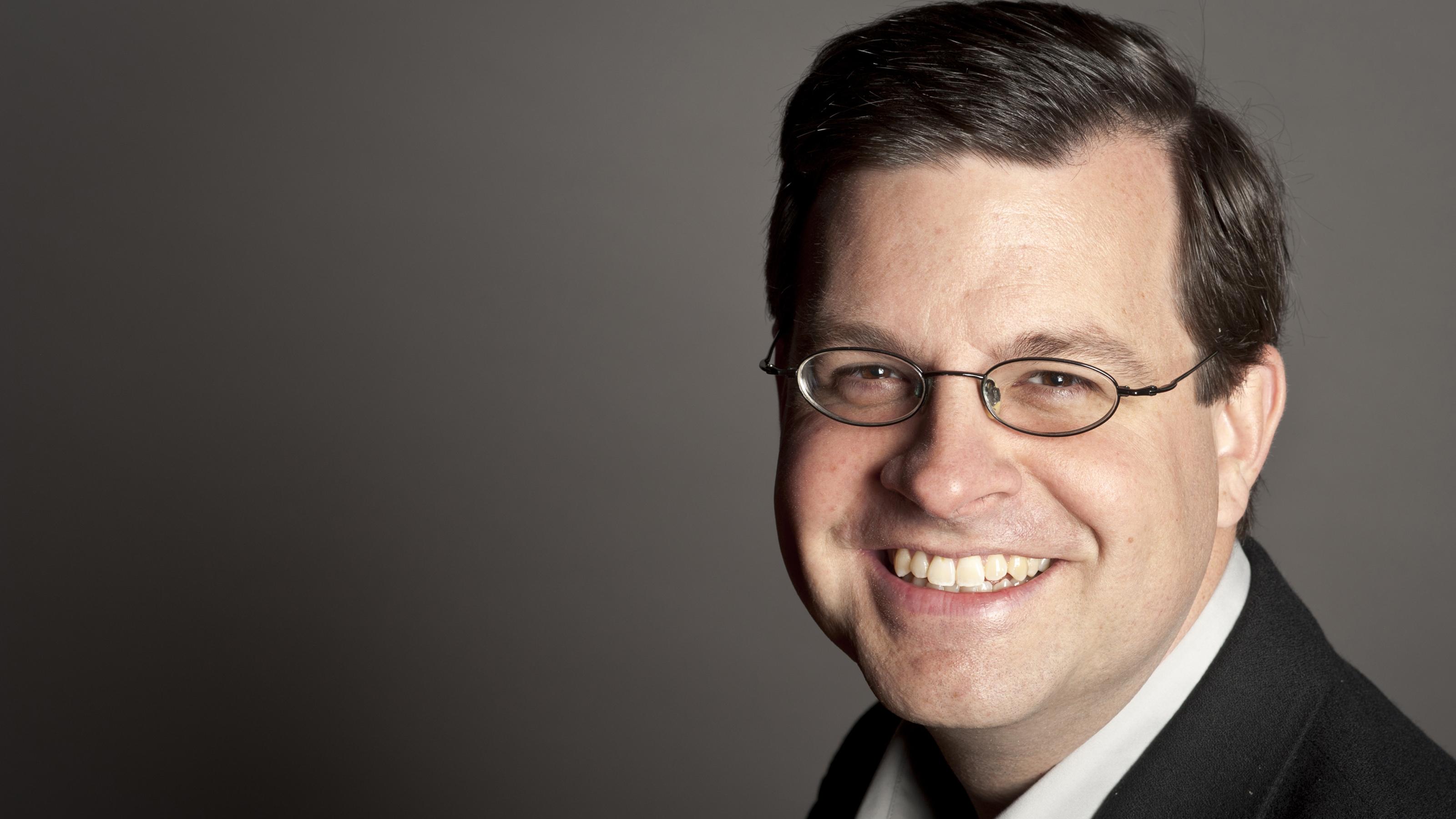 Dr Brian Biettrich against a gray background