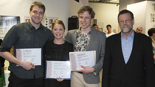Students from the 2014 exhibition pose for a photograph with their certificates.