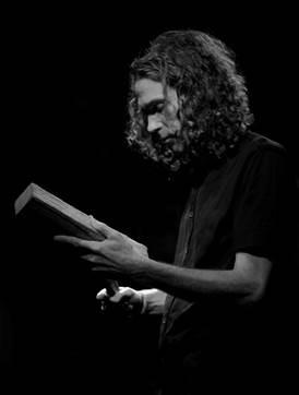 Image of Rob playing a taonga pūoro