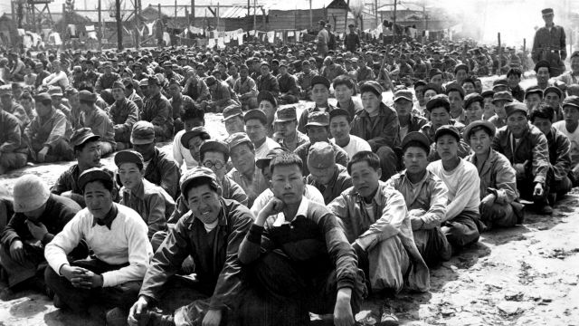 At the United Nations' prisoner-of-war camp at Pusan, North Korean and Chinese prisoners are assembled in one of the camp compounds.