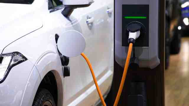 An electric car stationed for recharging.