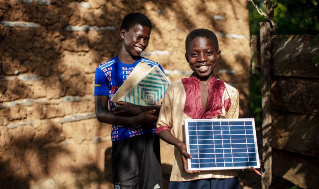 Kenyan children with a solar panel supplied as part of Karl Upston-Hooper's work