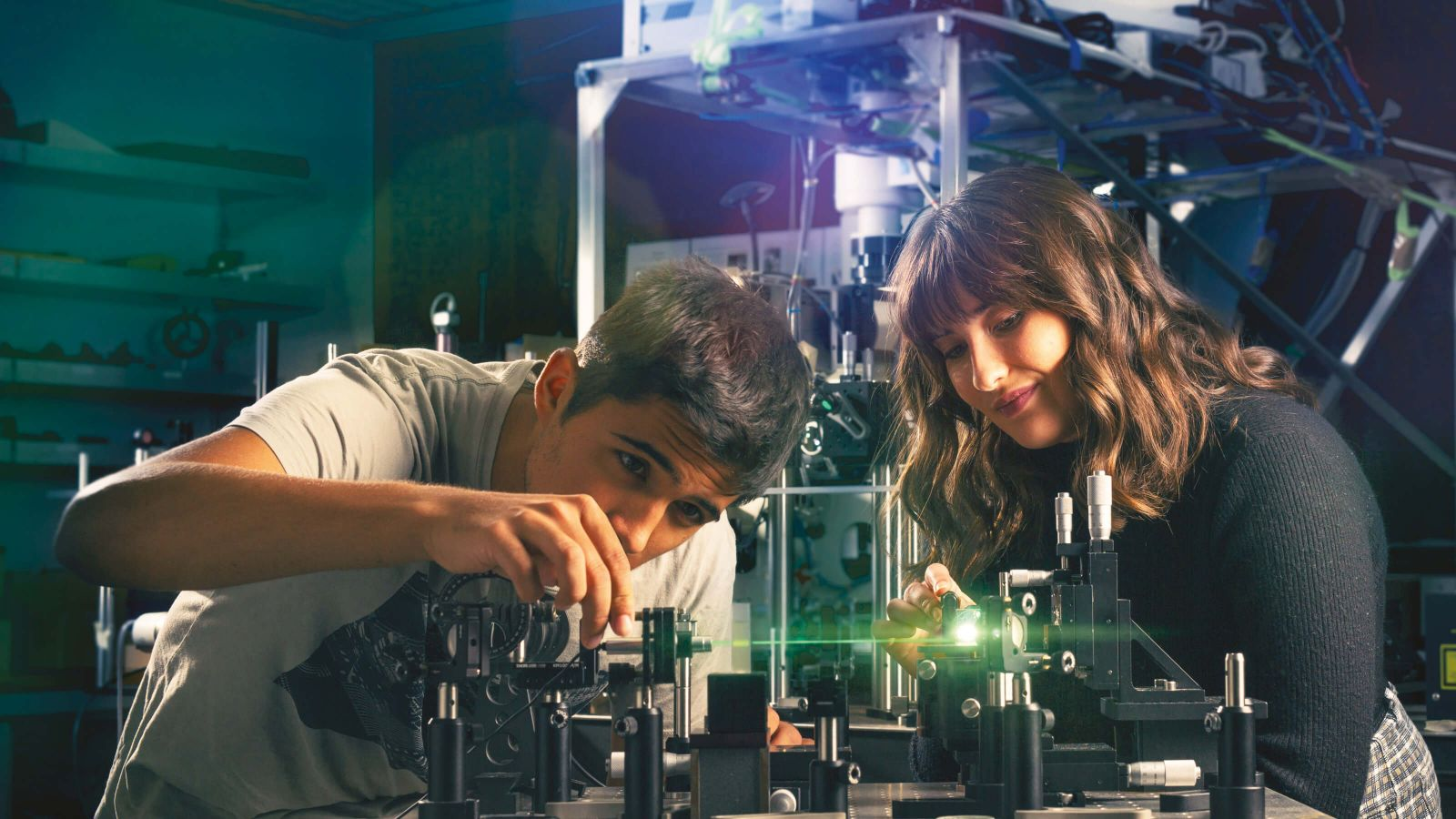 Science students Aleksa Djorovic and Phoebe McDougall experiment with light in Victoria's Raman Laser Laboratory.
