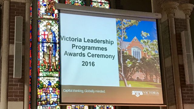 The banner of the Victoria International Leadership Awards 2016 against the backdrop of a beautiful stained-glass window.