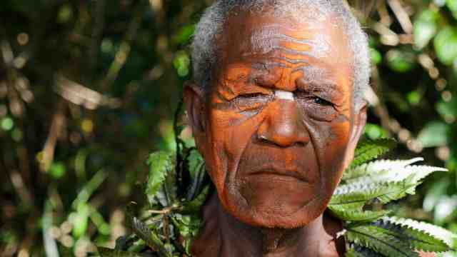 A film still from the documentary What Lies That Way featuring a man from Papua New Guinea.