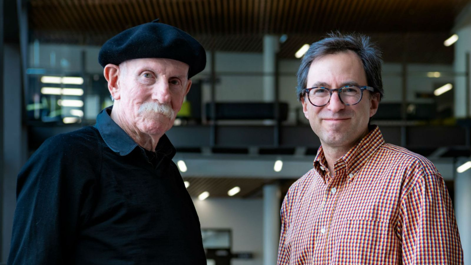 Professor Paul Atkinson and Dr Andrew Munkacsi stand side-by-side, looking at the camera.