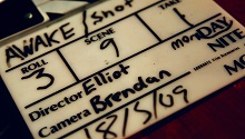 close-up of film frame board announcing shot