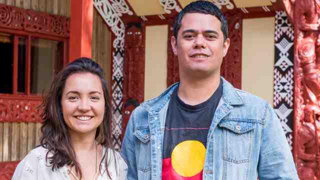 Iwi interns Ataria Sharman and Alan Hunt stand outside Marae