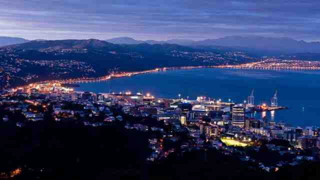 Aerial photo of Wellington city at night.